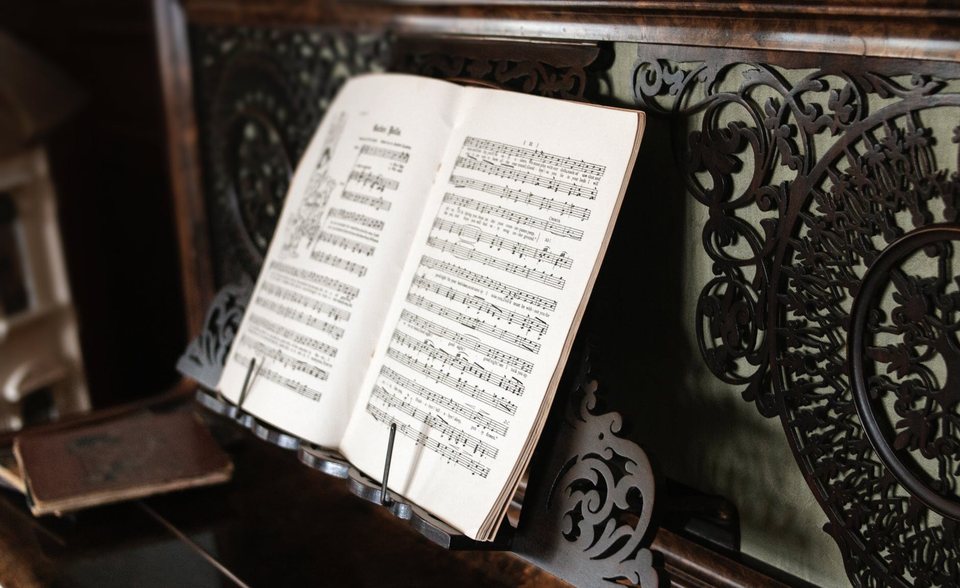 musical composition on wooden stand