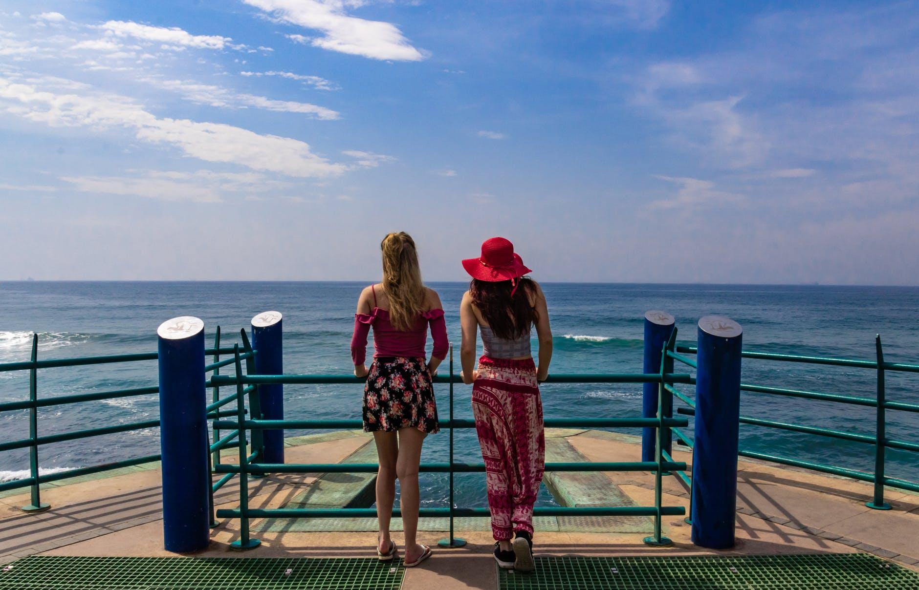 two women in boat looking at ocean