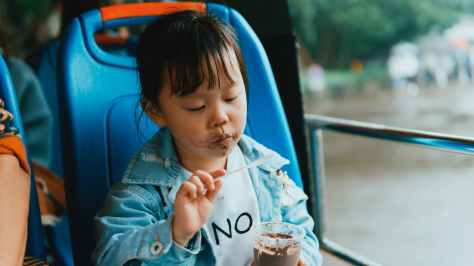close up photo of child eating ice cream