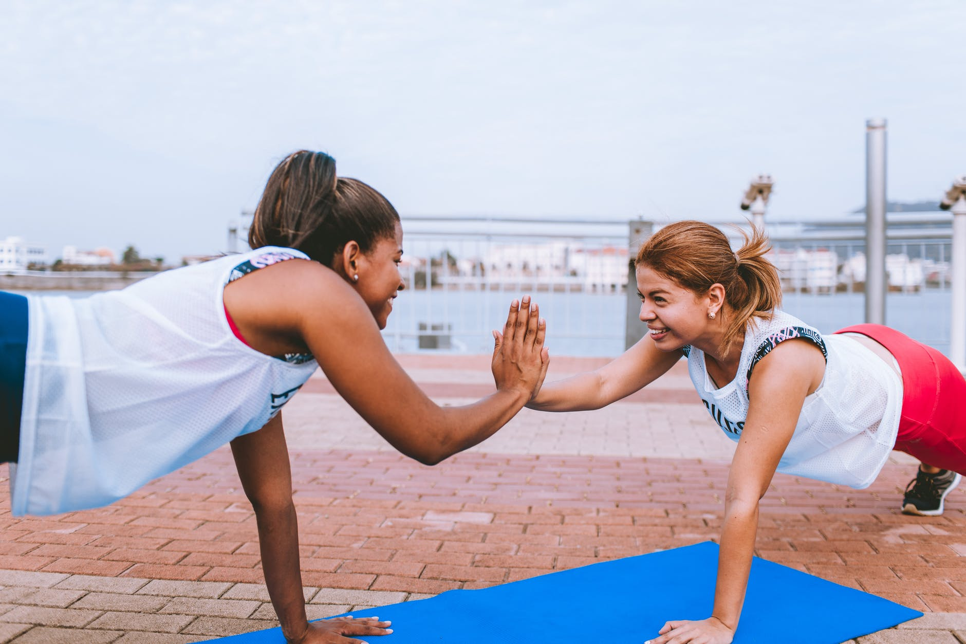 two woman doing exercise