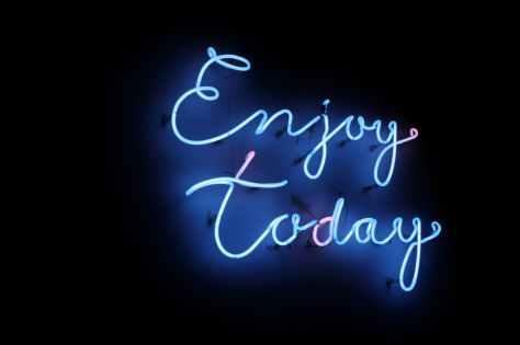turned on enjoy today neon signage